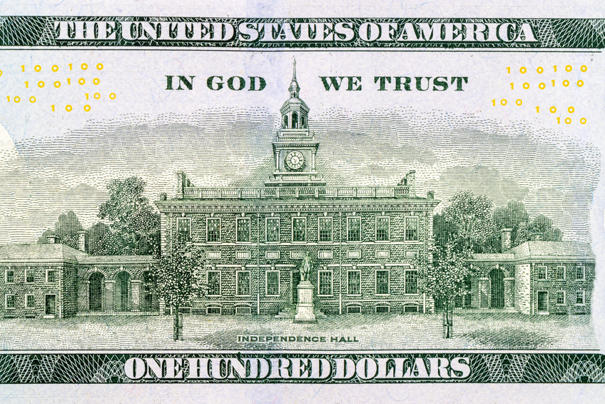 100 US dollar bills with in God we trust text. Background
